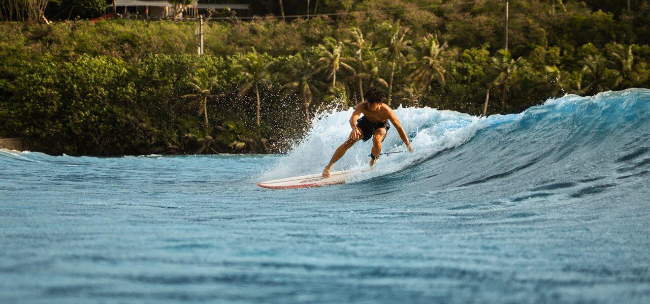 Surfer boy riding a wave.